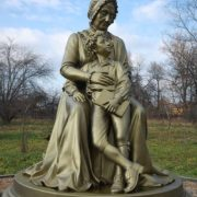 Not mother, but grandmother. The monument depicts great Russian poet Alexandr Pushkin with his granny. Monument in Zakharovo