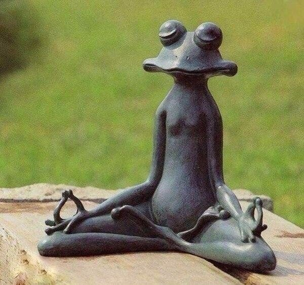 Meditating frog sculpture