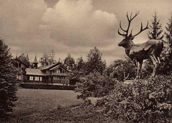 Sculpture of a deer against the background of the hunting estate of Kaiser Wilhelm II