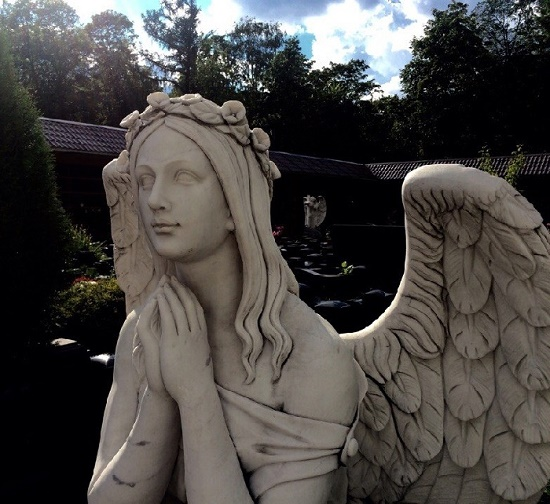 Beautiful angel grave sculpture in the Vvedensky Cemetery