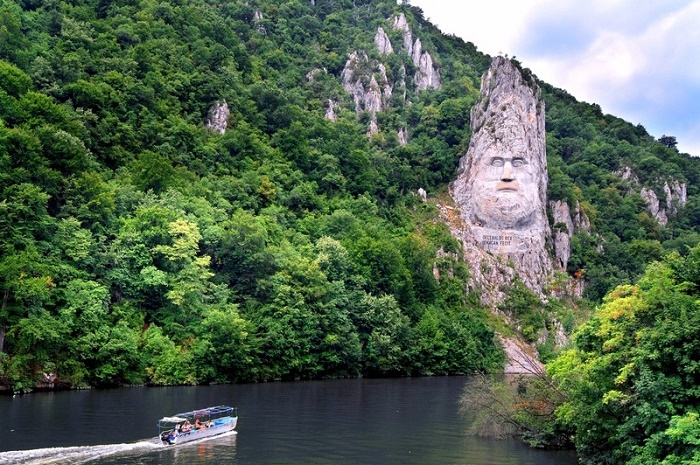 If your way passes through Serbia, then you can see the statue from the opposite bank of the river in good and clear weather