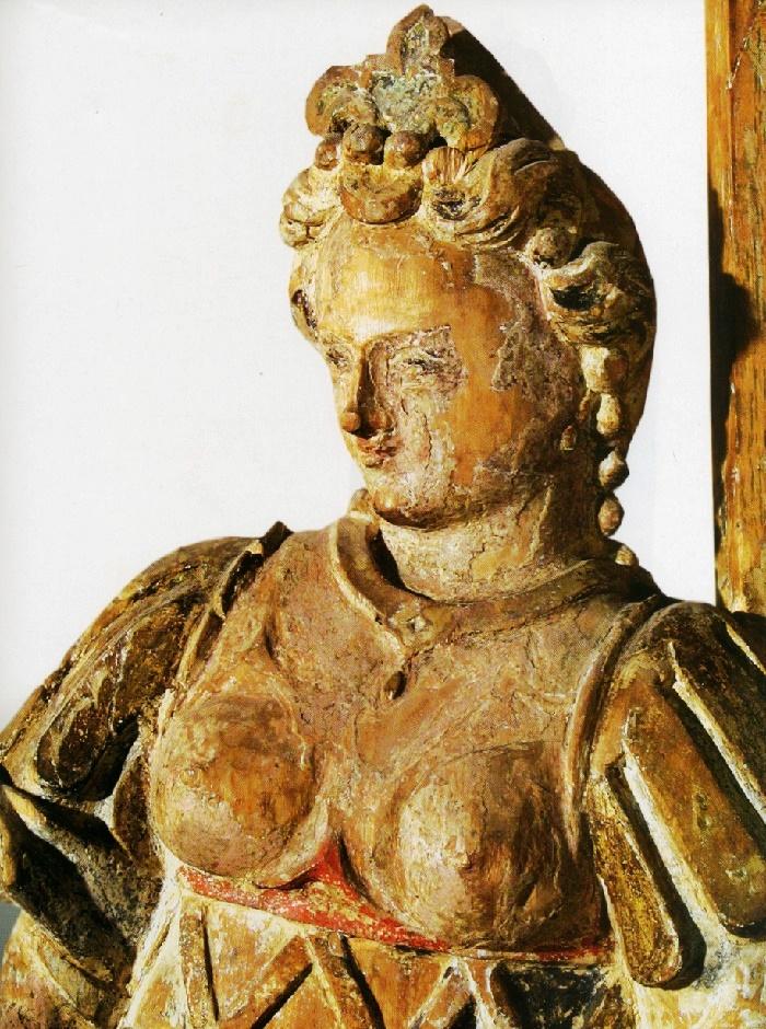 The 17th century sculpture (closeup). Wood, carving, multicoloured, Mokhavichy village Chapel, Lida district, Grodna region