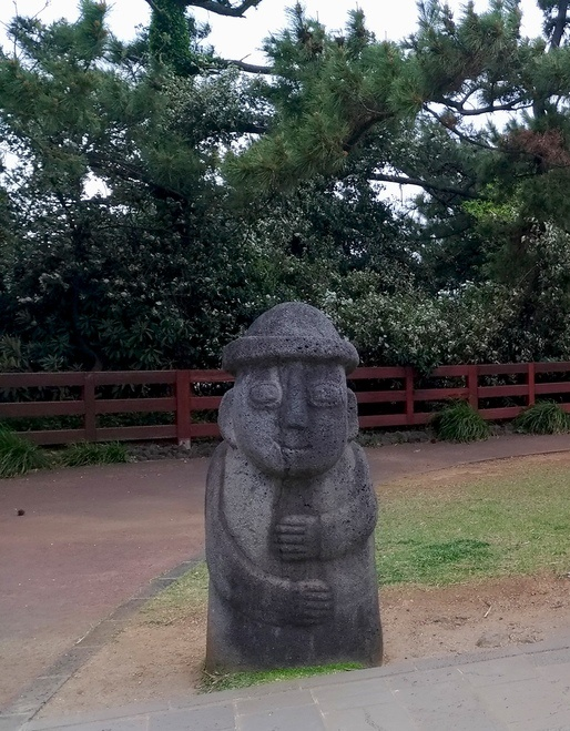 Typical rock sculpture of a dol hareubang on Jeju Island